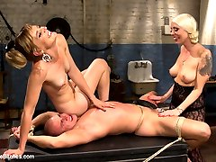Lorelei Lee and Mona Wales drag disrespectful cat caller down to their dungeon to put him in his place. They humiliate, and punish him with CBT, flogging, strap-on fucking before sitting on his face and using him as their personal play thing.