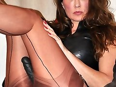 Strapon Jane slips in to a sultry pair of nylon stocking and a bit of leather to go with her big ebony strap on dildo,  before her virgins come over for a boink