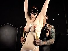 Big tit snow has her massive knockers tortured with ropes and pinchers in this bdsm movie