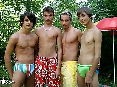 What better way to spend a hot Summer's day than blowing your buddies in a park.  These four tanned twinks have found a quiet corner in the bushes and are busy sucking cock like they are icy poles.  Billy can't handle the heat and stands up to jerk off while watching his mates gag on each other.  The other three continue on their fuckfest getting all sweaty and sticky with the cute blond getting the job of cum rag for the day.  The joy of Summer indeed!