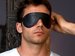 For his first time with another man and first time on video, we welcome straight hunk Atticus Cole.  He's a little nervous as we get started so we calm his nerves with a blindfold around his eyes before we start teasing his beautiful cock.  He gets nice and hard for us as we introduce him to the vibrating hitachi's while Sebastian sucks on the boy's nipples.  Atticus is then tied down in the chair, moaning with pleasure as we jack his dick off with the fleshjack.  Sebastian goes right for Atticus' beautiful toes to drive him wild as he begs for us to let him cum.  On the bed, we shove a dildo up the bound stud's ass while sucking on his cock from behind.  We then flip him on his back and shove a ball gag in his mouth before introducing the fucking machine.  As the machine pounds away on his hole, Atticus finally blows his load all over his stomach before receiving post-orgasmic torment.
