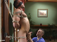 Gorgeous, muscular and covered in beautiful hair, Alex Mecum is a sight to behold as he's bound in ropes, blindfolded and edged to the limit! He writhes in frustration and ecstasy as his massive cock is sucked, stroked and gripped while his nipples are tightly pinched in clamps and his balls are teased with the hitachi. Next Alex is strapped down to the pool table with his gorgeous furry ass high up in the air as he receives a nice hard fucking with the dick on a stick, his balls bouncing as his hard cock is stroked mercilessly. Finally, after being tied to the bed and tickled, with his feet worshipped and a vibe shoved deep into his ass, Alex blows his huge load all over himself and then falls prey to another onslaught of tickling!