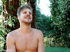 Logan Stevens is dragged down from the woods to be used at the cabin by the horny campers. They take him to the fire pit where some strangers whip their dicks out and make him worship feet with an electric butt plug shoved up his ass. They make the boy work through the electricity to get to their cocks and he takes them two at a time. In the hot tub they fuck his ass and dunk him making him switch between a mouth full of cock and being underwater. At the outdoor shower they piss all over the stud while keeping his holes full of cock, then cover him in their cum.