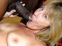 Kinky mama munching on a bunch of black cocks
