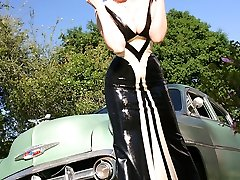 huge-boobed redhead slips off rubber in vintage car