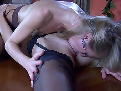 Temptingly dressed lesbians tongue their pussies in 69 after some necking