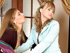 Lusty business-lady wetting a girls pussy and shoving her strap-on into it