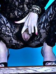 Dark-haired stunner stuffs her hairy pussy thru her black lacy bodystocking