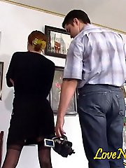 Black-stockinged gal doing it with kinky cameraman right in the art gallery