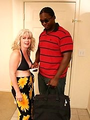 Lusty MILF sucking on a fat ebony cock