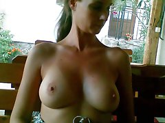 Horny amateur babe flashes her tits outdoors