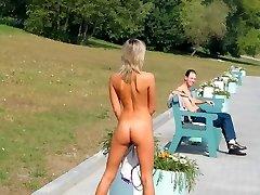 Naked blondie enjoys the street flashing