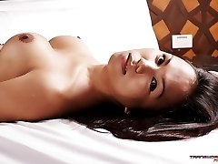 Moka skinned Asian Shemale putting her nude body on display for you