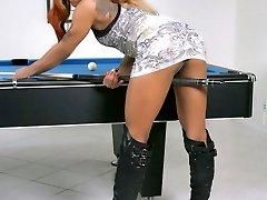 Black goddess Candi Love posing on the pool table