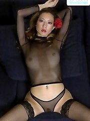 Young Asian temptress posing in sexy black nylons
