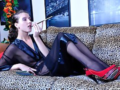 Smoking hot lady leaves her cig and puts on a strapon to screw her male sub