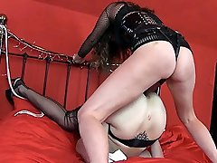 Strapon Jane dominates the lovely Ava Austins pussy with her big black strapon