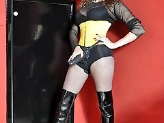 Female Domination Belt Dick Jane plays with her huge strapon cock dressed in fishnets, boots and yellow corset
