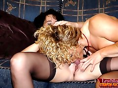 Two cute moms enjoy lesbian sex fucking pussies with a strapon dildo