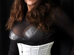 Gorgeous Strapon Jane has on a sexy white corset and her famous strapon
