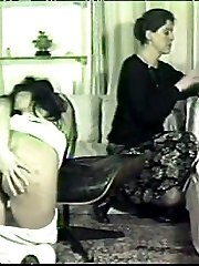 School girl caned in the living room with her exposed ass high in the air - hard strokes