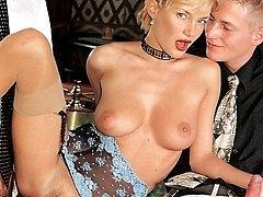 Blonde slurping two dicks