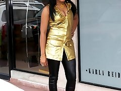 sexy girl wearing a shiny latex catsuit