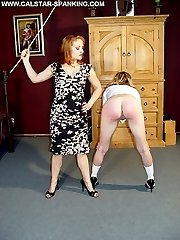 Young schoolgirl is ferociously spanked and humiliated by cruel Mistress