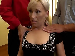 MILF poker player lets horny folks squeeze her boobs