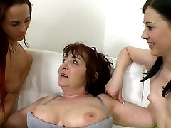 This older lesbian friend gets a hell of a kick out of turning these two youngsters into raving...