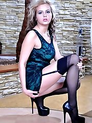Busty chick in a too short dress flashing the straps of her raunchy nylons