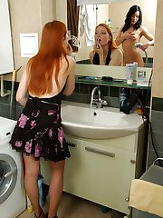 Two cuties fondling their pussies clad in soft pantyhose in the bathroom