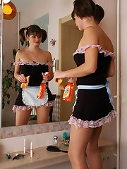 French maid in lacy tights taking fun from fucking in front of the mirror