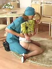 Filthy doctor lowering babe�s silky pantyhose to examine her sweet holes