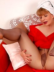 Angel in grey colored, shiny and sheer stockings