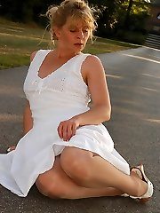 Angel outside in shiny and sheer pantyhose