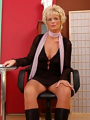 Joanne as sexy secretary in tan pantyhose and boots
