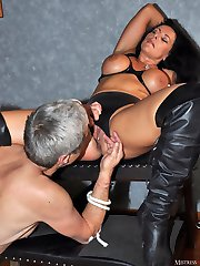 Sexy Mistress Carly grinds on one of her sissy slaves cocks while the other watches and whimpers.