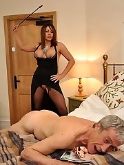 Dominatrix Carly delectations herself on the bed until her slave arrives with the dildo mask! Then ready and willing she shovels her ass in the air and ordered him to plow her vagina and lick it clean