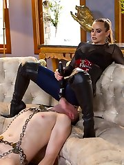 Divine Bitch, Mistress Bella Rossi, shows up to the Armory in her tight blue jeans and determines to wear them for the shoot! She was sweating in these flesh taut dickblowers all the way to the Armory and they are cute and musky and drenched for her slave. Her tall ebony leather boots drive him nuts until he is basically humping her leg like a poor dog. Dominatrix Bella jerks his prostate until penis dirt won't stop dribbling from his manmeat then fucks his dick until she gets off and makes him spill his humungous load all over her black leather shoes!