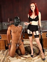 Mz. Berlin trusses her slave's balls tight and makes him pull against his ball bondage until he can pull no further.  She whips and smacks his ass before having him crawl onto the restrain bondage bed so she can tie off his ball bondage to the end of the table.  She dishes out a cruel cropping while he pulls on his ball bondage.  She trades in the rattan whip for a solid wooden cane.  Then she videos and pinches his tightly bound ballsack.