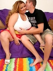 Lusty plumper Vivian squeezes a plump and stiff dick between her large jugs and gets her face...