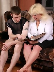 Mature blonde plumper gags on a stiff swarthy cock