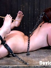 Jodi starts her day on her back in a very strict steel device that allows no movement. She is...