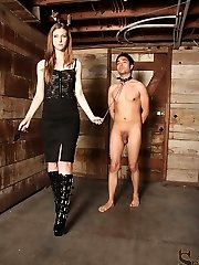Femdom Ellie has her slave in a tough spot. His balls are tied to his feet, so he cant stand up....