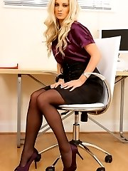 Beautiful Meklaina dressed as a secretary wearing a blouse and a skirt but more importantly some...