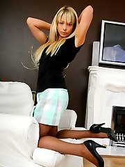 Beauty Kirsty in miniskirt and creme lingerie.
