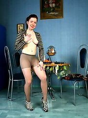 Pantyhose flasher teases with her downskirt view and hot nylon close-ups