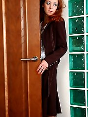 Red-haired chick takes out and tries on her newly bought black shaping hose