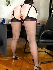 Cute secretary in back seam stockings caressing her pink before hot legjob